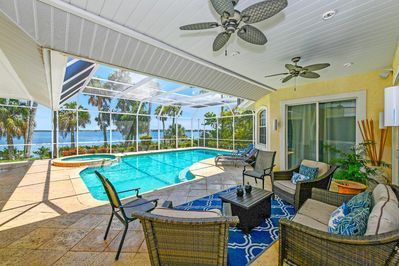 The large screened in patio has plenty of lounging chairs to enjoy being outside and watching boats drive by....