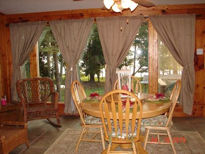 The dining table in the sunroom overlooking the lake.