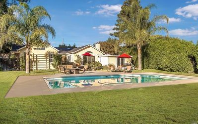 Photo for Bright and spacious home on half acre w/pool, hot tub, great entertaining house!