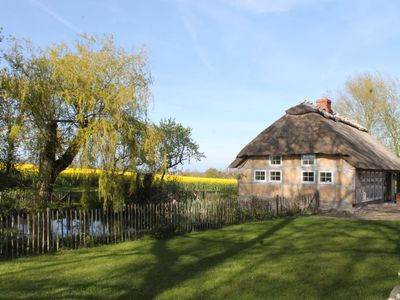 Photo for Cozy thatched cottage with large fireplace and sauna (up to 20 percent weekly discount on request)