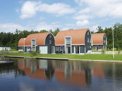 Photo for Luxury 10-person bungalow in the holiday park Landal De Bloemert - on the water/recreation lake