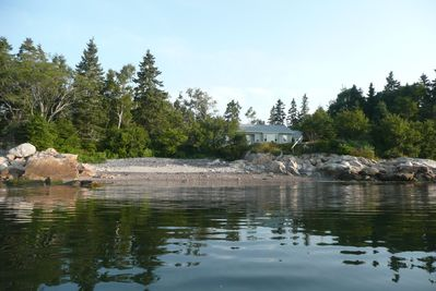 View of the house on a kayak at high tide