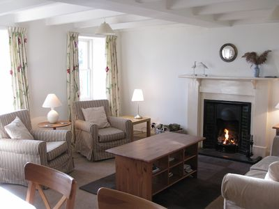 Sitting-room with open fire and sea views