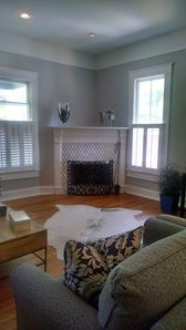 A corner gas fireplace warms guests in the spacious living room