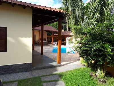 Photo for BERTIOGA, POOL, AIR CONDITIONING, COND. CLOSED COSTA DO SOL, 90 meters from the beach