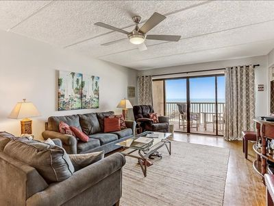 Photo for Top Floor Oceanfront condo!  Modern updates and a  W/D in unit. Community grills, private fishing pier and tennis courts!