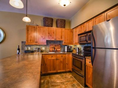 Beautiful kitchen with heated tiles and stainless appliances