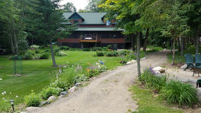 Landscaping, gradual path from lake to front of cabin, fire pit near lake.
