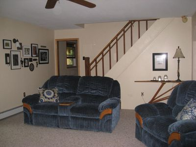 Large living room with oversized comfy furniture. A double and single recliner.
