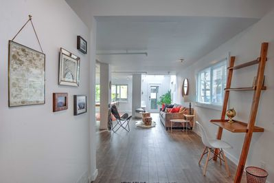 Large front entrance with gallery wall and work space