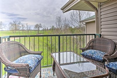 Look out to rolling pastures and golf course views from your private deck.