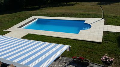 Photo for A farmhouse set in its own secure grounds with a private, outdoor pool.