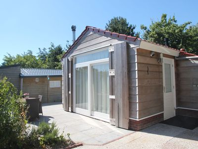 Photo for Comfortable chalet with spacious terrace in a small park close to the beach