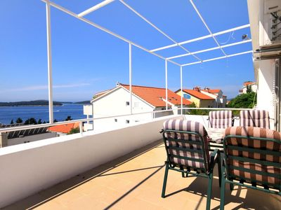 Photo for Two bedroom apartment with terrace and sea view Hvar (A-115-a)