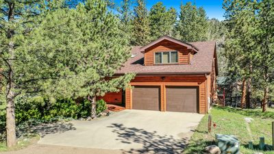 Photo for PRIME RIVER FRONTAGE - 5 BEDROOM 4000 SQFT HOME - WALK TO THE RMNP AND YMCA