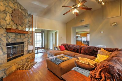 Relax in the cozy living area, complete with couches and a stone fireplace.