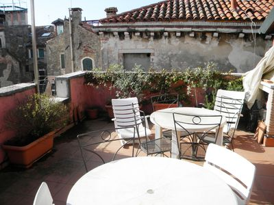 Photo for Top floor with large terrace furnished and flourished in Venice