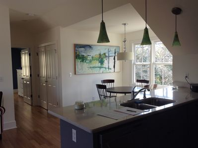View from kitchen into dining area and hall to bedroom.  Lots of natural light.