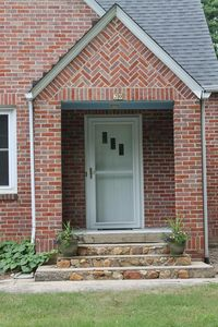 Beautiful front porch and stairs welcome you as you arrive