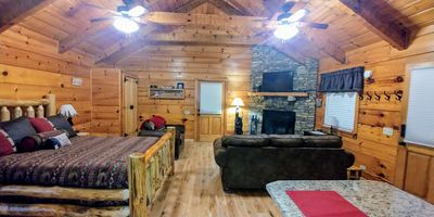 Photo for Newly updated cabin, 10 min to pkwy in Pigeon Forge. Sleeps 4, hot tub,WIFI.