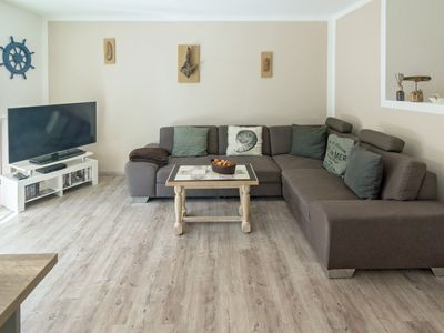 Photo for This modern apartment is centrally located and was completed in September 2013. A furnished terrace is a big plus and invites you to relax, the modern infotainment in this apartment convinced every technology fan.