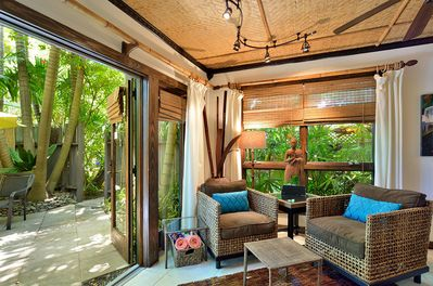 A tropical atmosphere is created with thatched ceiling and cool tile floors.