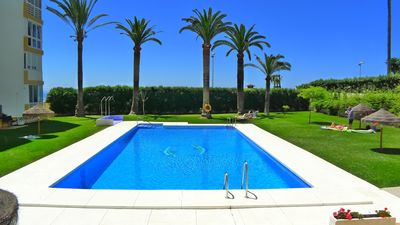 Photo for Front Line holiday apartment with large terrace,  A/C, free wifi & pool