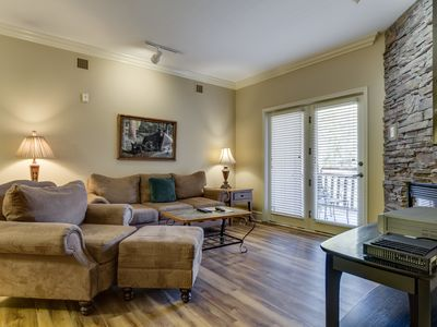 Photo for Beautiful downtown condo w/ gas fireplace & shared hot tub/pool/gym!