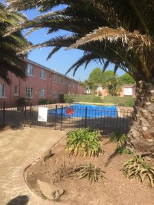 Photo for Paignton Seaside Apartment with heated outdoor pool and secure parking.