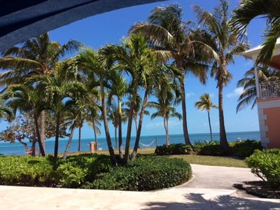 Photo for Luxury condo with white sand beach right out the back door and marina out front.