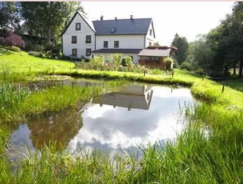 Photo for Holiday apartment overlooking the trout pond
