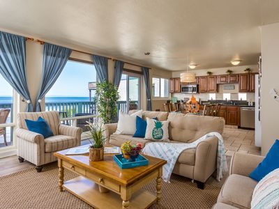 Condo on the Beach with an Oceanfront Balcony and Patio.