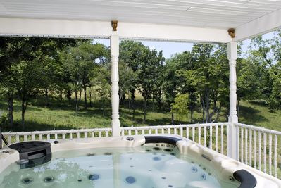 Relax in the private 6 person hot tub as you take in the beautiful Ozarks view.