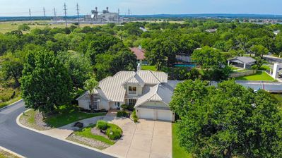 Photo for Beautiful  waterfront home on  lake LBJ sits on a large double lot with POOL!!!