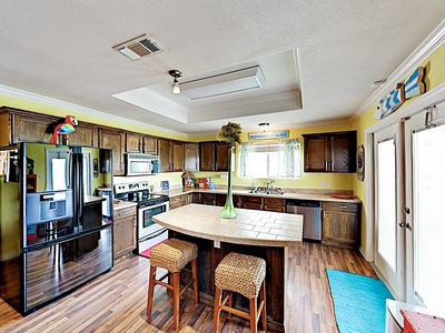 Kitchen - A spacious kitchen features a full suite of appliances and a 2-person island area.
