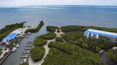 Photo for Ocean Pointe Suites Official- 2/2 with Private Beach, Marina, Pool