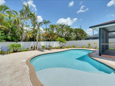 Photo for ** Tropical Pool Home less than 1 mile to the beach ** ONLY $150 a night