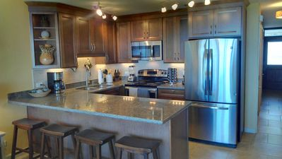 Remodeled kitchen is fully open so you can enjoy the ocean views!