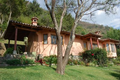 Main House, high on the hillside, has spacious grounds and incredible views.