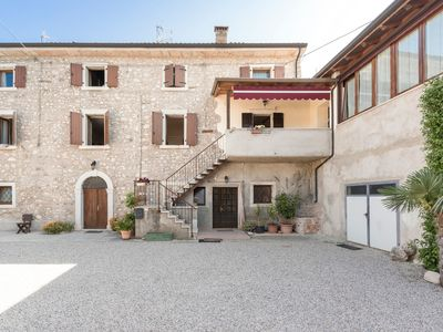 """Photo for Beautiful Holiday Apartment """"Casa Adriano II Castion/Campagnola"""" Close to Lake Garda with Mountain View, Wifi & Garden; Parking Available"""