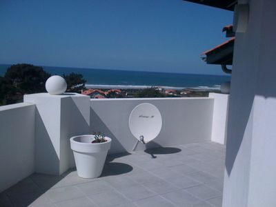 Photo for Top floor with large terrace, 180 ° view of the Ocean, 300m from the beach!