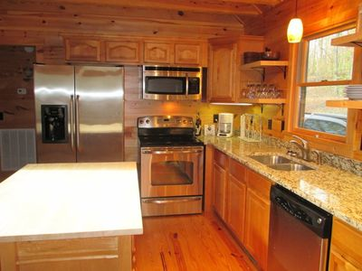 Fully equipped kitchen with granite counter-tops and stainless steel appliances
