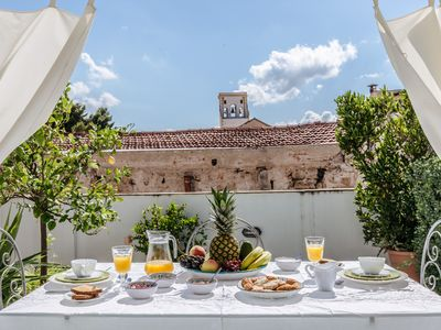 Photo for Terrace, charm and relax in the heart of La Kalsa by Wonderful Italy