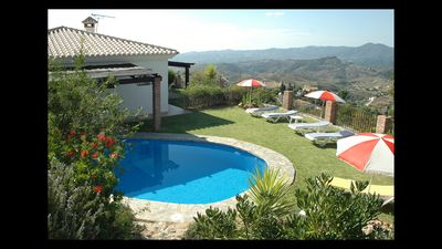 Photo for A comfortable villa with mature gardens and a fenced pool area.