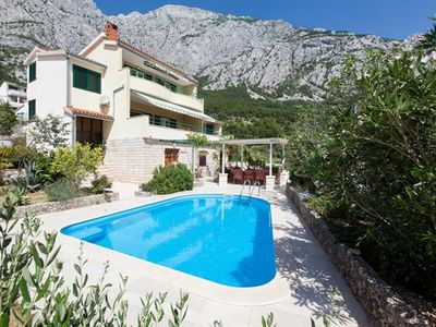 Photo for Holiday house with air conditioning, an outdoor pool and sea views