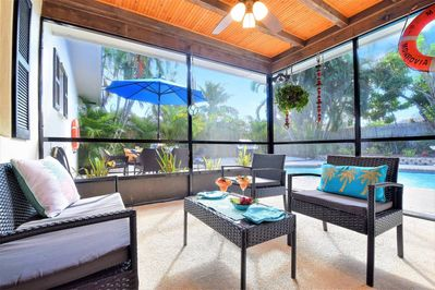 Relax under a shaded screened patio