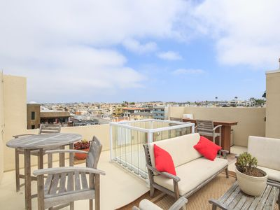 Photo for 1000' foot rooftop deck in 3 bedroom Hermosa w/AC!  -  3 houses from beach!