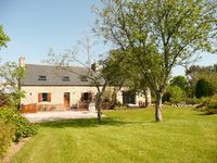 A quiet country farmhouse overlooking fields, yet within easy reach of essential shops.