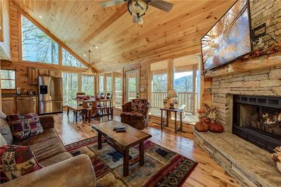 Your Smoky Mountain home away from home - With its wood-planked walls, floors, and ceilings, stacked-stone fireplace, and huge windows looking out over woodlands toward the Great Smoky Mountains, the living room is everything you want from a mountain cabin.
