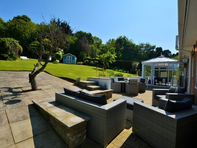Coastal property with beautiful enclosed garden with summer house